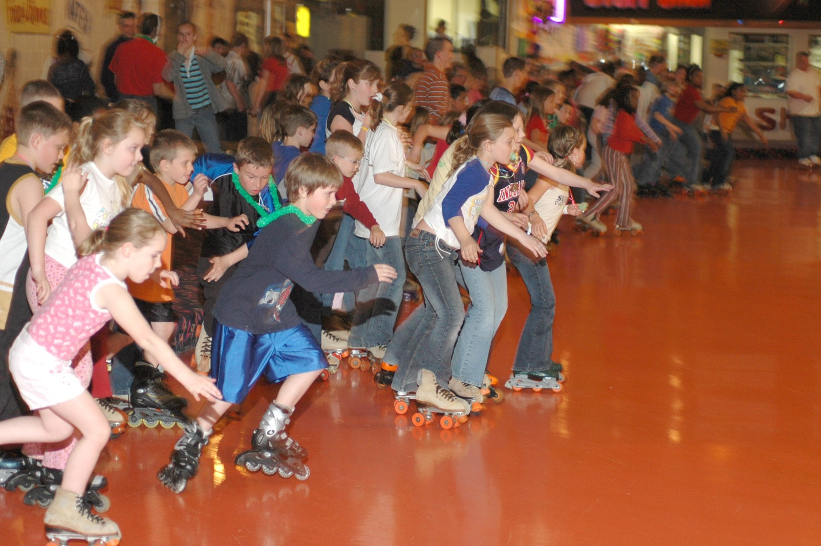 Group Of Kids Having Fun Roller Skating